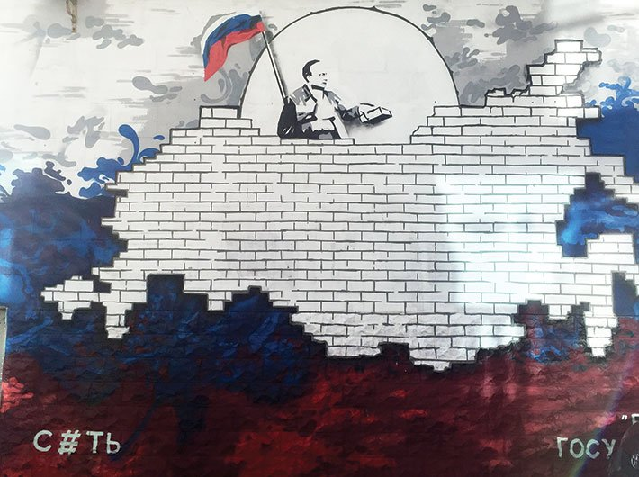 A wall graffiti near the Sevastopol naval base showing Putin fortifying Crimea brick by brick